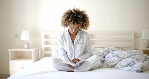 Woman Reading A Book On Bed Stock Photography