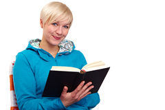 Woman reading book in blue sweater Stock Photo