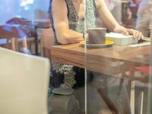 Woman reading book in cafe stock image