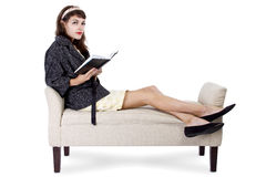 Woman Reading a Book on a Chaise Lounge Stock Images