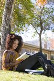 Woman Reading Book In College Campus Royalty Free Stock Image