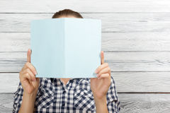 Woman reading a book and covering her face over Stock Photo
