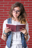 Woman reading a book with eyesight glasses Royalty Free Stock Image