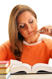 Woman reading a book. Female student learning Royalty Free Stock Image