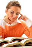 Woman reading a book. Female student learning Stock Images