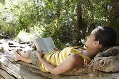 Woman Reading Book In Forest royalty free stock photo