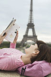 Woman Reading Book In Front Of Eiffel Tower Stock Images