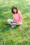Woman reading a book in the garden Royalty Free Stock Images
