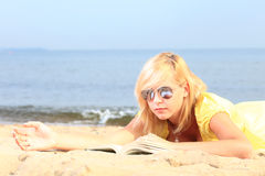 Woman reading book girl yellow dress Royalty Free Stock Photography