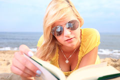 Woman reading book girl yellow dress Stock Photography