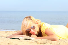 Woman reading book girl yellow dress Royalty Free Stock Photos