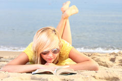 Woman reading book girl yellow dress Stock Images