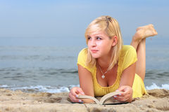 Woman reading book girl yellow dress Royalty Free Stock Images