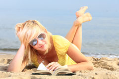 Woman reading book girl yellow dress Stock Image
