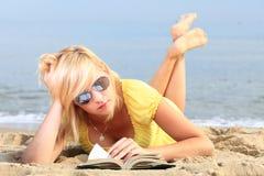 Woman reading book girl yellow dress Stock Photo