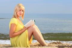 Woman reading book girl yellow dress Stock Photography