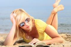 Woman reading book girl yellow dress Royalty Free Stock Image