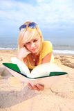 Woman reading book girl yellow dress Stock Photo