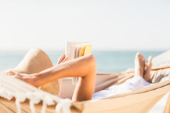 Woman reading book in hammock Royalty Free Stock Image