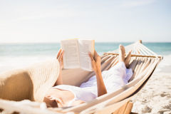 Woman reading book in hammock Stock Photos