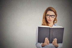 Woman reading book having thought Royalty Free Stock Image