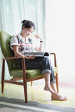 Woman reading a book at home Stock Image