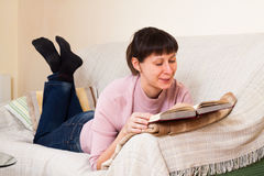 Woman reading a book Stock Photos