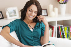 Woman reading book at home Royalty Free Stock Photo