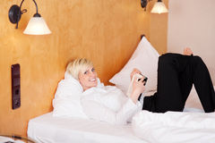 Woman Reading A Book In The Hotel Room Stock Images