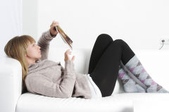 Woman reading book laying on back Royalty Free Stock Photography