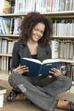 Woman Reading Book At Library Royalty Free Stock Photos