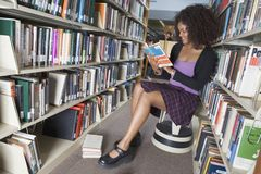 Woman Reading Book In Library Royalty Free Stock Photos
