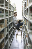 Woman Reading Book In Library Aisle Royalty Free Stock Images