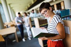 Woman reading a book at the library Stock Image