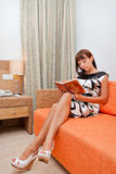 Woman is reading book Royalty Free Stock Image