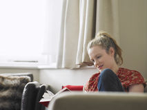 Woman Reading Book In Living Room Royalty Free Stock Images