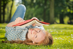 Woman Reading a Book in Nature Stock Photos