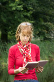 Woman reading a book in nature stock photo