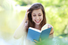 Woman reading book outdoors Royalty Free Stock Images