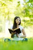 Woman reading book outdoors Royalty Free Stock Photography