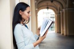 Woman reading book outdoors Royalty Free Stock Photos