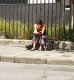 Woman reading book outdoors Stock Photos