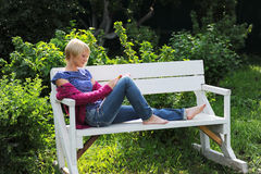 Woman reading book in park Royalty Free Stock Photography
