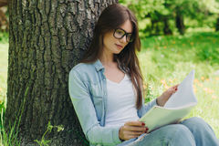 Woman reading a book in park Royalty Free Stock Photo