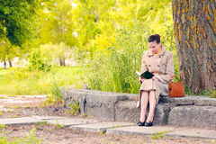 Woman Reading a Book in the Park in Spring royalty free stock photography