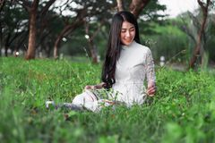 Woman reading a book in the park. Young woman reading a book in the park Stock Photography