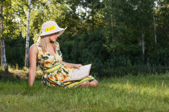 Woman reading a book in the park Stock Photos