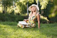 Woman reading a book in the park Stock Photography