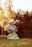 Woman reading a book in the park Royalty Free Stock Images