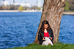 Woman reading a book in the park Royalty Free Stock Photos